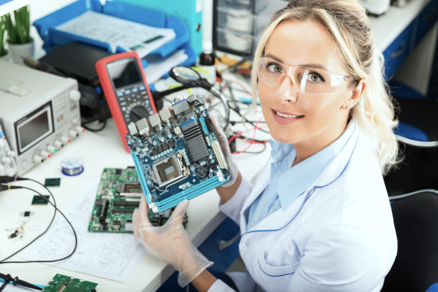 woman examining semiconductor part
