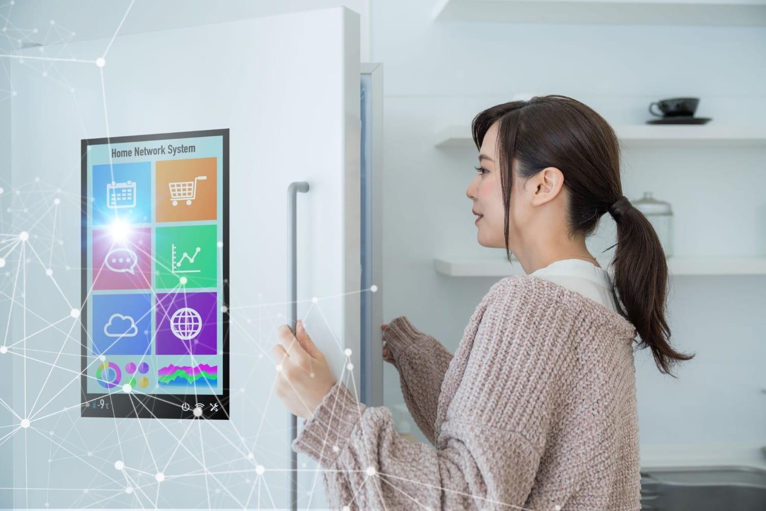 Woman opens a smart refrigerator concept