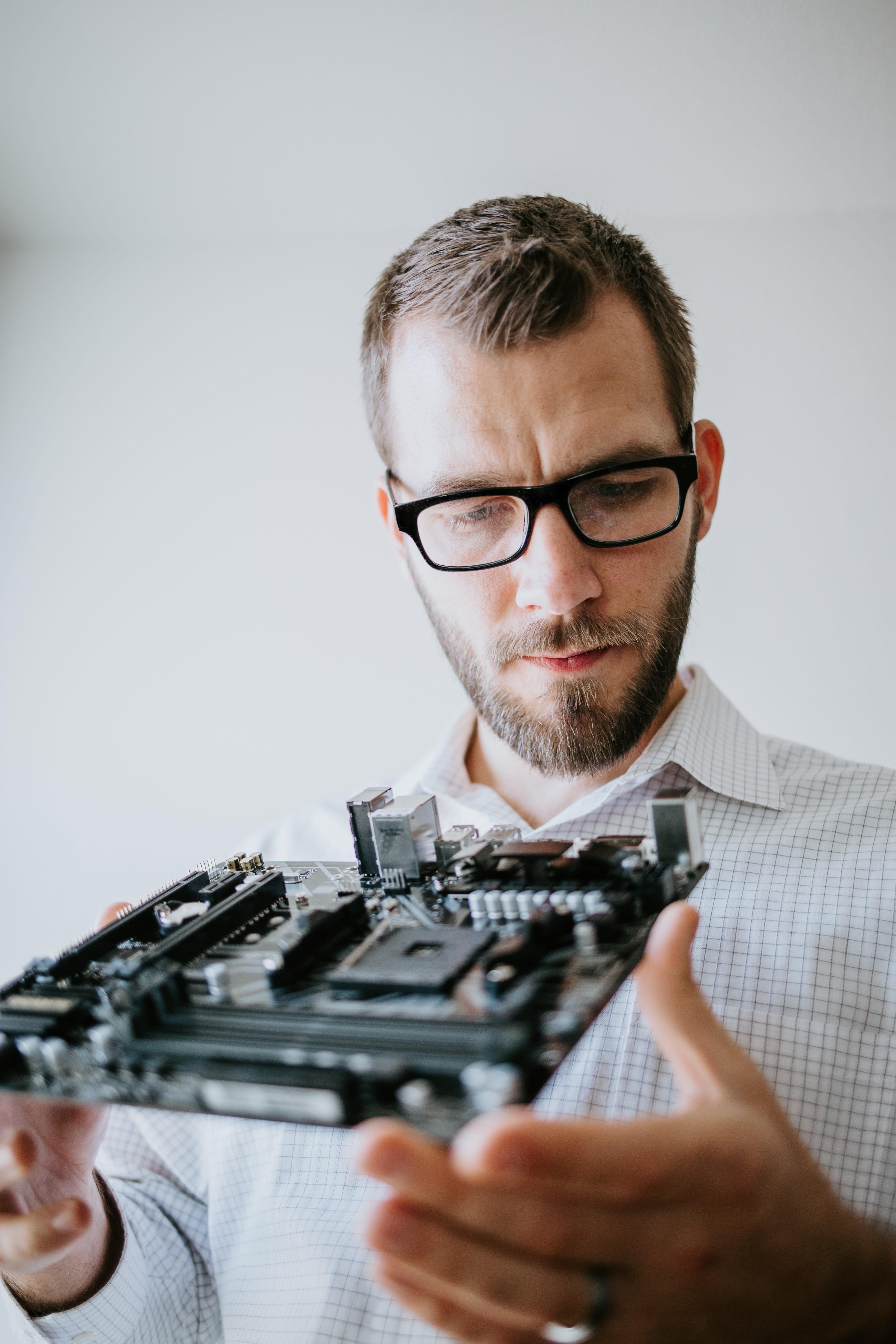 Computer Technician holding internal part of a desktop